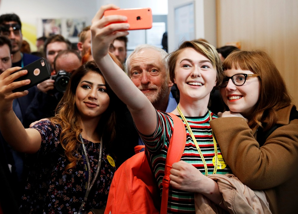 FILE PHOTO: Jeremy Corbyn, the leader of Britain's opposition Labour Party, poses for selfies at a campaign event in Leeds, May 10, 2017. REUTERS/Phil Noble