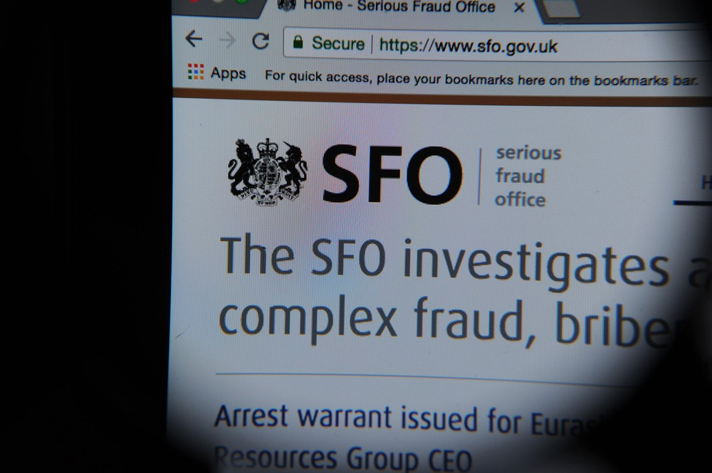 The Serious Fraud Office website seen through a magnifying glass. Contributor: Louisa Svensson / Alamy Stock Photo