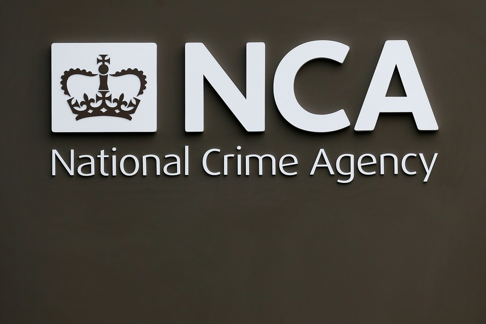 FILE PHOTO: A sign is seen outside the National Crime Agency (NCA) headquarters in London October 7, 2013. REUTERS/Stefan Wermuth