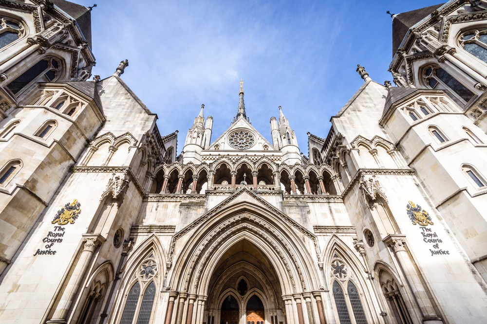 London, UK - October 25, 2015: Known as The Law Courts, The Royal Courts of Justice, located in Westminster, houses the High Court and Court of Appeal of England and Wales. Many high profile cases have been carried out here.