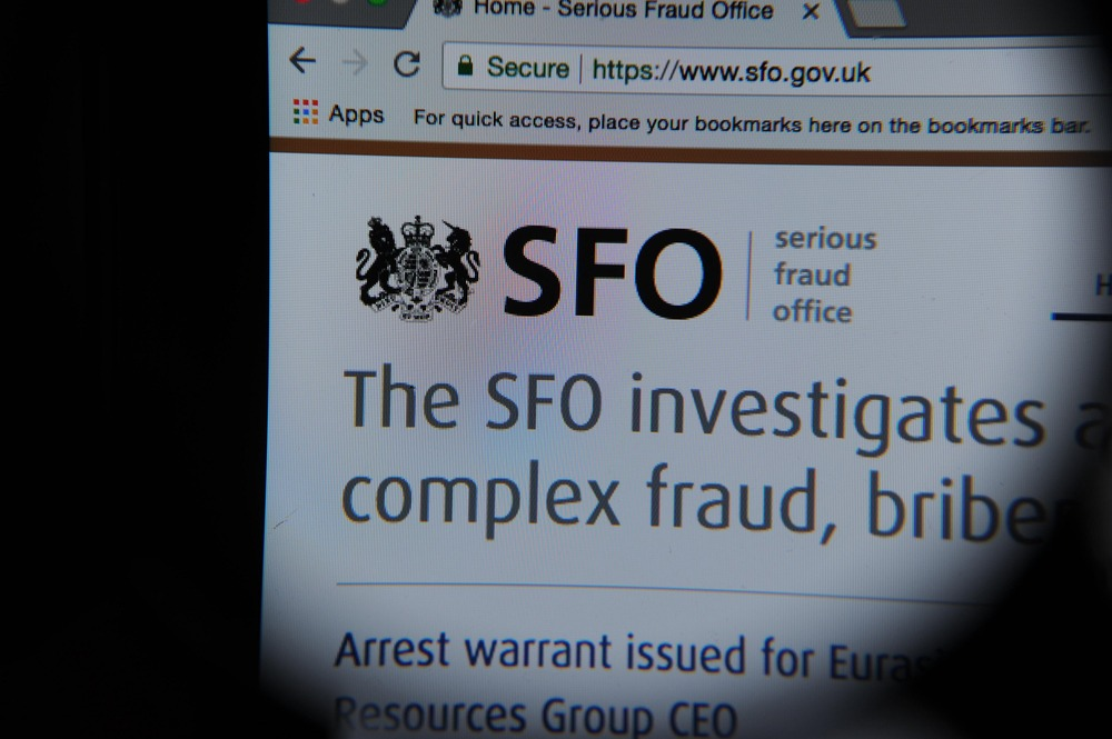 PD980F The Serious Fraud Office website seen through a magnifying glass