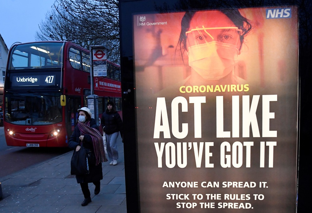 A public health information message is seen at a bus stop in West Ealing as the South African variant of the novel coronavirus is reported in parts of the United Kingdom amid the spread of the coronavirus disease (COVID-19), London, Britain, February 1, 2021. REUTERS/Toby Melville