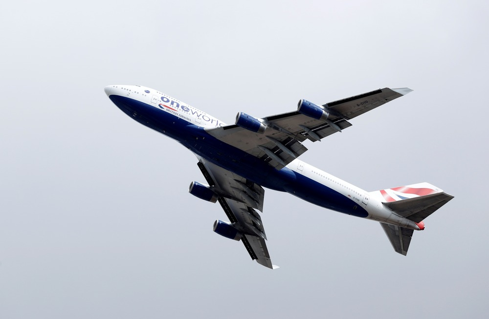 FILE PHOTO: A British Airways Boeing 747 G-CIVD leaves London Heathrow airport on it's final flight, the first of 31 jumbo jets to be retired early by the airline due to the coronavirus disease (COVID-19) pandemic, in London, Britain August 18, 2020. REUTERS/John Sibley/File Photo