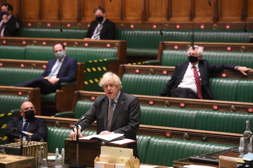 Britain's Prime Minister Boris Johnson speaks during a session on the coronavirus disease (COVID-19) pandemic at the House of Commons in London, Britain January 27, 2021. UK Parliament/Jessica Taylor/Handout via REUTERS
