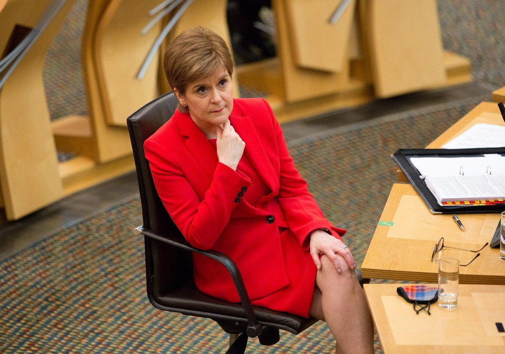 FILE PHOTO: Scottish First Minister Nicola Sturgeon attends a session at the Parliament in Edinburgh, Scotland Britain January 28, 2021. Robert Perry/Pool via REUTERS