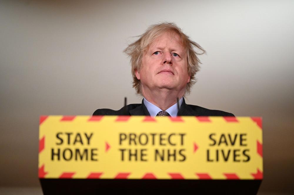 FILE PHOTO: Britain's Prime Minister Boris Johnson holds a coronavirus disease (COVID-19) pandemic media briefing at 10 Downing Street in London, Britain February 22, 2021. Leon Neal/Pool via REUTERS