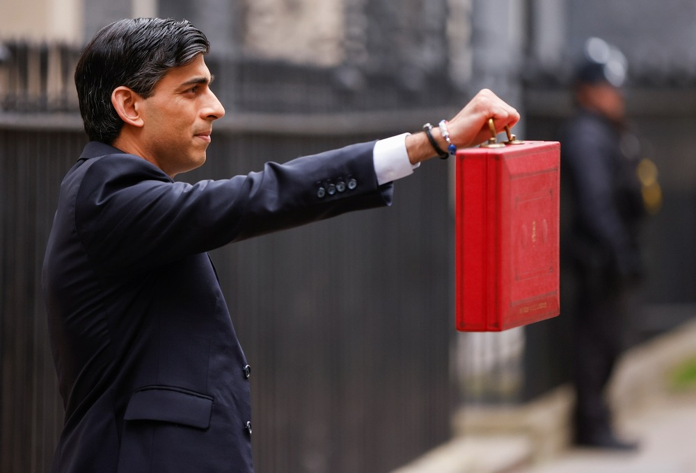 Britain's Chancellor of the Exchequer Rishi Sunak holds the budget box outside his office in Downing Street in London, Britain March 3, 2021. REUTERS/John Sibley