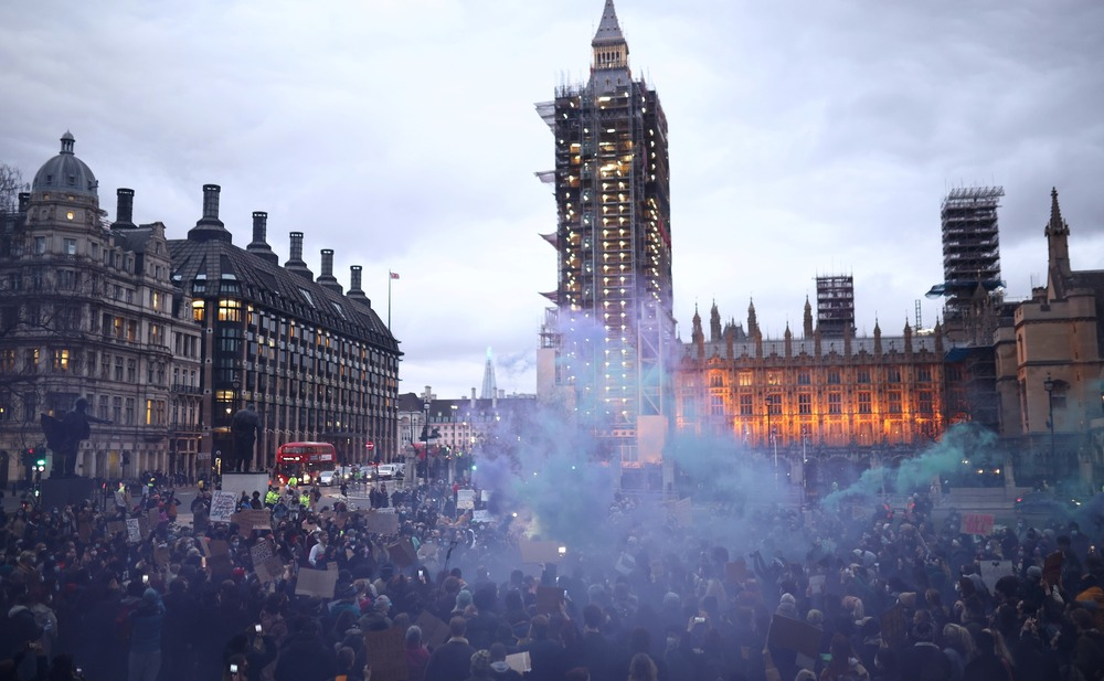 Flare smoke rises over a protest at Parliament Square, following the kidnap and murder of Sarah Everard, in London, Britain, March 16, 2021. REUTERS/Henry Nicholls