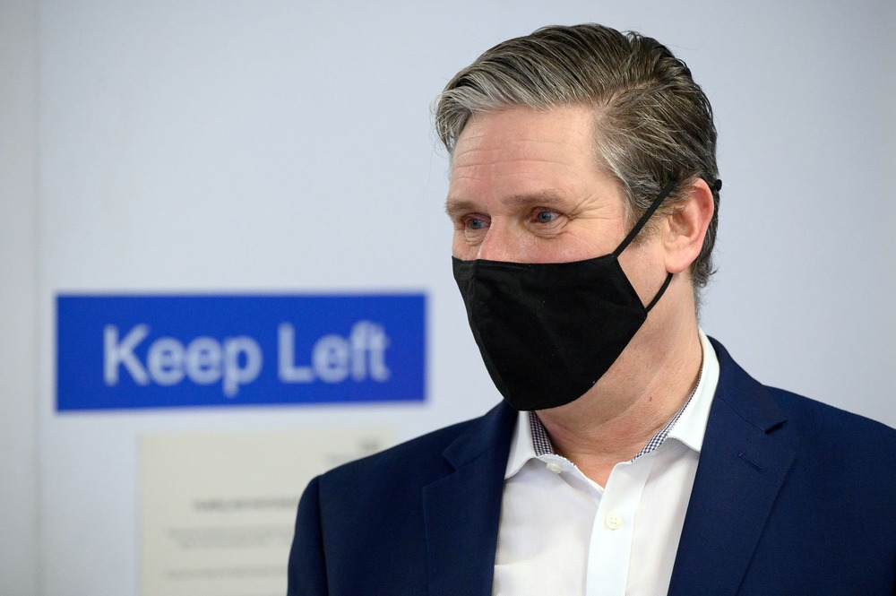 Labour Party leader Keir Starmer speaks with medical staff during a visit to the Whittington Hospital in London, Britain, March 15, 2021. Leon Neal/Pool via REUTERS