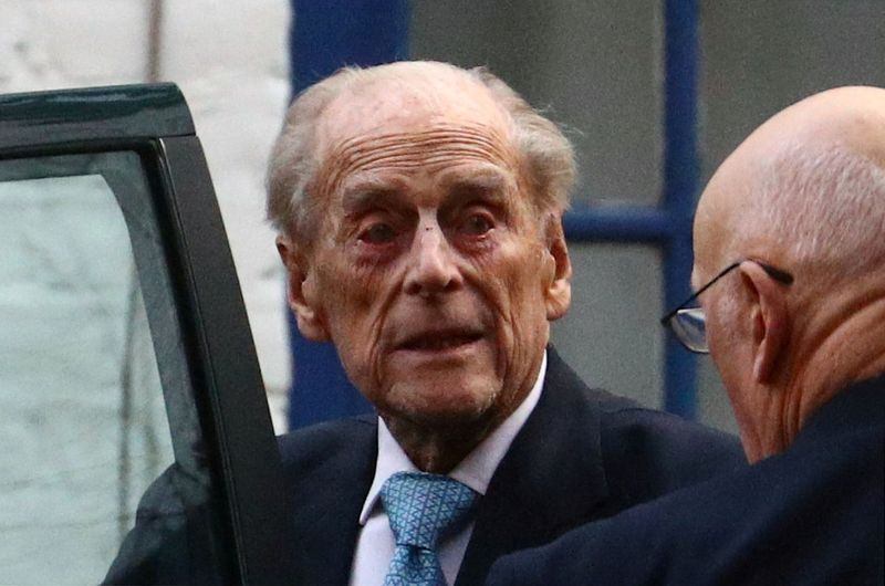 FILE PHOTO: Britain's Prince Philip enters a car as he leaves the King Edward VII's Hospital in London, Britain December 24, 2019. REUTERS/Hannah McKay/File Photo