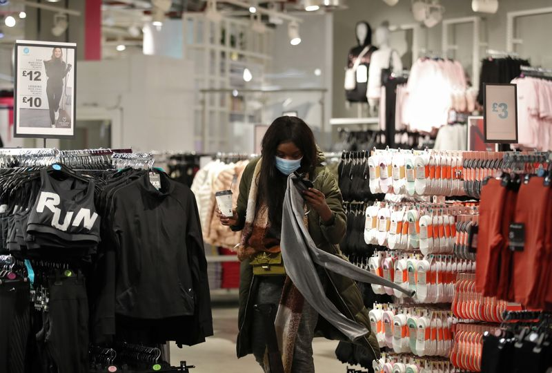 Customer shops inside as retail store Primark in Birmingham, Britain reopens its doors after a third lockdown imposed in early January due to the ongoing coronavirus disease (COVID-19) pandemic, April 12, 2021. REUTERS/Carl Recine