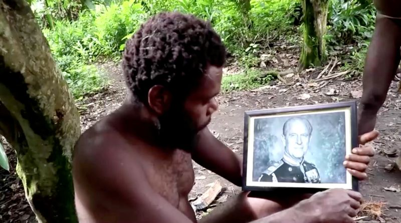 A man holds a picture of Britain's Prince Philip as the late Duke's devotees hold a mourning ceremony in his honour on the island of Tanna in Vanuatu in this screengrab taken from a video on April 12, 2021. REUTERS TV via REUTERS
