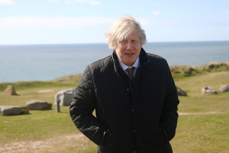 Britain's Prime Minister Boris Johnson visits the Haven Perran Sands Holiday Park in Perranporth, Cornwall, Britain April 7, 2021. REUTERS/Tom Nicholson