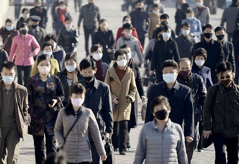 eople wearing protective face masks commute amid concerns over the new coronavirus disease (COVID-19) in Pyongyang, North Korea March 30, 2020, in this photo released by Kyodo. Mandatory credit Kyodo/via REUTERS