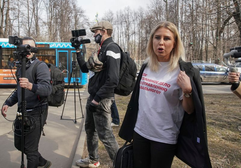 Lyubov Sobol, a Russian opposition figure and a close ally of Kremlin critic Alexei Navalny, speaks with journalists upon her arrival at a court building in Moscow, Russia April 15, 2021. REUTERS/Tatyana Makeyeva