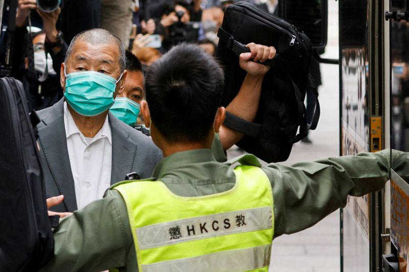 Media mogul Jimmy Lai, founder of Apple Daily, leaves the Court of Final Appeal by prison van in Hong Kong, China February 9, 2021. REUTERS/Tyrone Siu