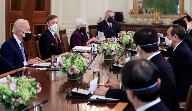 U.S. President Joe Biden holds an expanded bilateral meeting with Japan's Prime Minister Yoshihide Suga in the State Dining Room at the White House in Washington, U.S., April 16, 2021. REUTERS/Tom Brenner