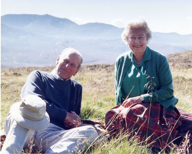 Handout image released by Buckingham Palace of a personal photograph of the Britain's Queen Elizabeth II and Prince Philip, the Duke of Edinburgh at the top of the Coyles of Muick, taken by The Countess of Wessex in 2003, obtained by Reuters on April 16, 2021. The Countess of Wessex via PA Wire/Handout via REUTERS