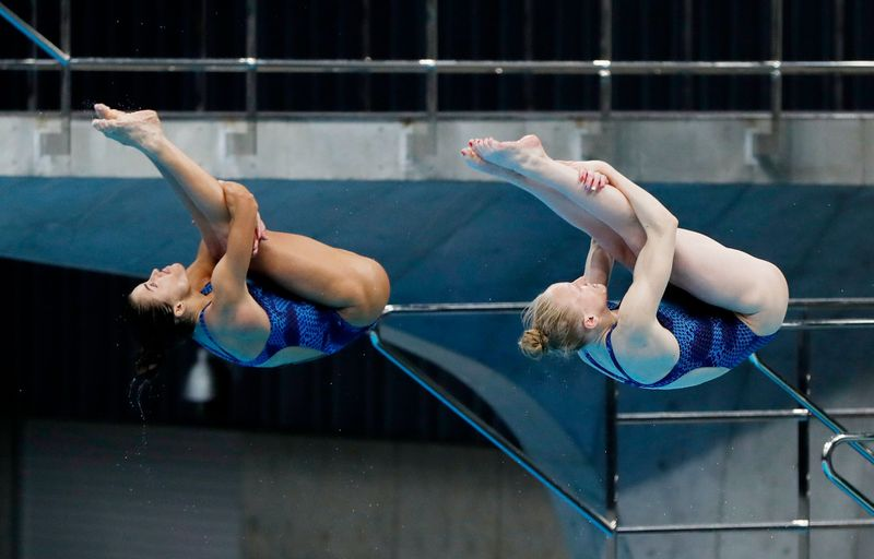 Diving - FINA Diving World Cup 2021 and Tokyo 2020 Olympics Aquatics Test Event - Tokyo Aquatics Centre, Tokyo, Japan - May 1, 2021 Kassidy Cook and Sarah Bacon of the U.S. in action during the women's 3m synchronised springboard final REUTERS/Issei Kato