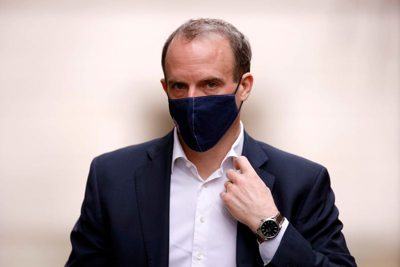 Britain's Foreign Affairs Secretary Dominic Raab walks outside Downing Street in London, Britain, February 3, 2021. REUTERS/John Sibley