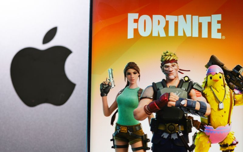 Fortnite game graphic is displayed on a smartphone in front of Apple logo in this illustration taken May 2, 2021. REUTERS/Dado Ruvic/Illustration