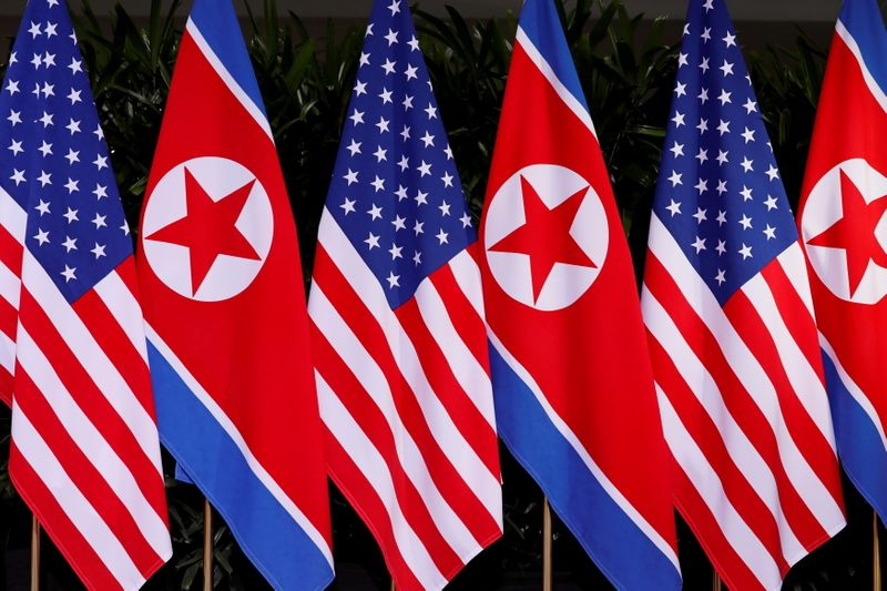 FILE PHOTO: U.S. and North Korean national flags are seen at the Capella Hotel on Sentosa island in Singapore June 12, 2018. REUTERS/Jonathan Ernst