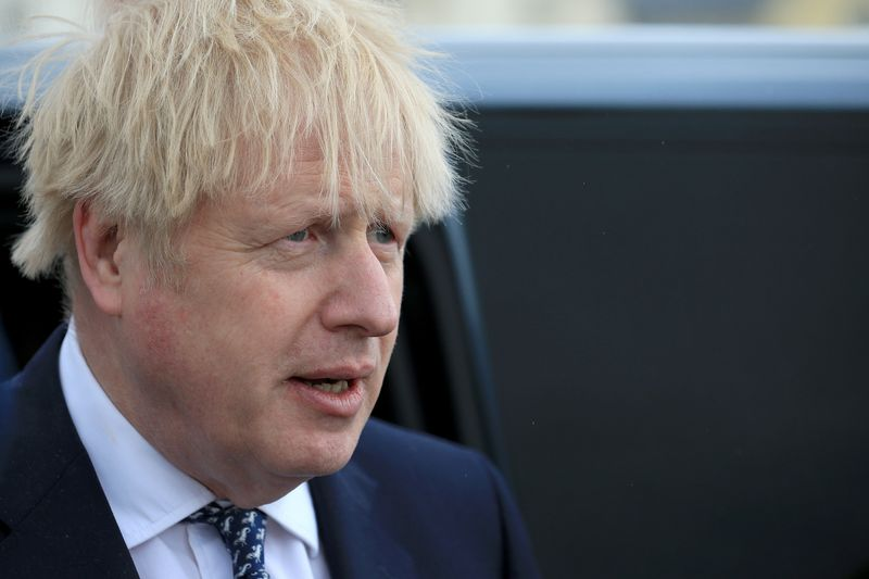FILE PHOTO: Britain's Prime Minister Boris Johnson looks on as he campaigns on behalf of Conservative Party candidate Jill Mortimer in Hartlepool, Britain May 3, 2021. Lindsey Parnaby/Pool via REUTERS