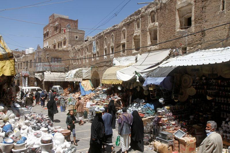 FILE PHOTO: People shop at a market in the old quarter of Sanaa, Yemen April 9, 2020. REUTERS/Mohamed al-Sayaghi/File Photo