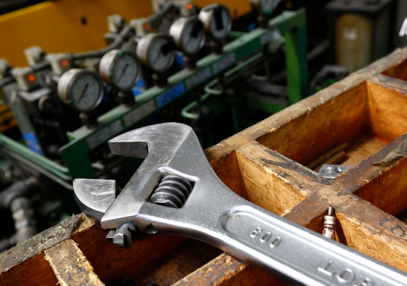 FILE PHOTO: A wrench lies on a workbench at manufacturing firm Sigma UK in Hinckley, central England, May 1, 2013. REUTERS/Darren Staples