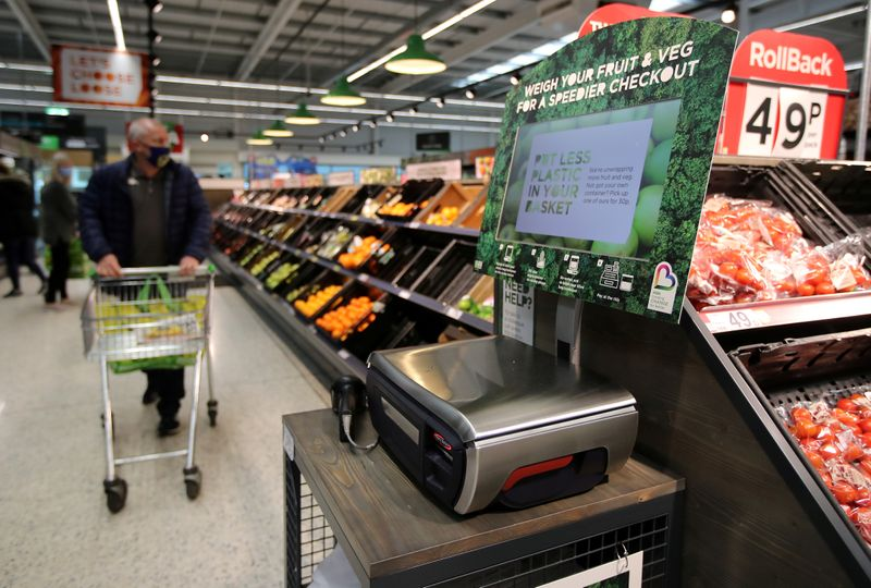 FILE PHOTO: Scales to weigh loose fresh produce are seen in the UK supermarket Asda in Leeds, Britain, October 19, 2020. REUTERS/Molly Darlington/File Photo