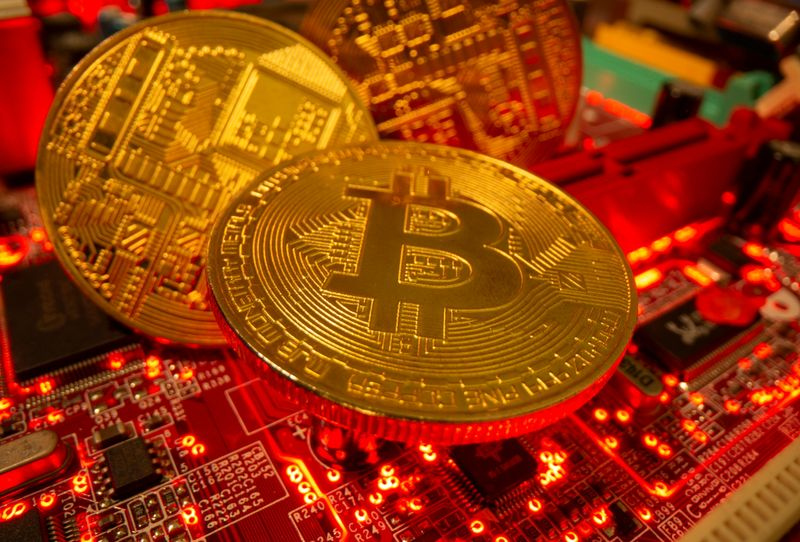 FILE PHOTO: Representations of the virtual currency Bitcoin stand on a motherboard in this picture illustration taken May 20, 2021. REUTERS/Dado Ruvic/Illustration