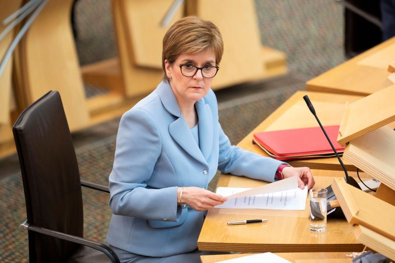 FILE PHOTO: Scotland's First Minister Nicola Sturgeon attends the session to elect Scotland's First Minister at Holyrood, at the Scottish Parliament in Edinburgh, Scotland, Britain May 18, 2021. Jane Barlow/Pool via REUTERS