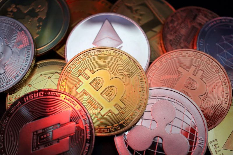 FILE PHOTO: Representations of cryptocurrencies including Bitcoin, Dash, Ethereum, Ripple and Litecoin are seen in this illustration picture taken June 2, 2021. REUTERS/Florence Lo/Illustration/File Photo