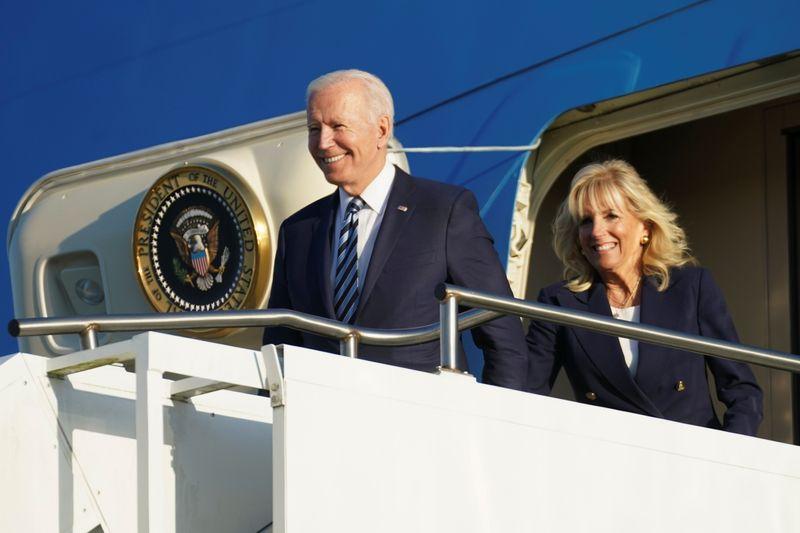 U.S. President Joe Biden and first lady Jill Biden disembark from Air Force One after landing at RAF Mildenhall ahead of the G7 Summit, near Mildenhall, Britain June 9, 2021. REUTERS/Kevin Lamarque