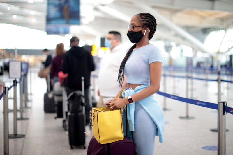 Passengers wait at the Terminal 5 departures area at Heathrow Airport in London, Britain, June 10, 2021. REUTERS/Hannah McKay