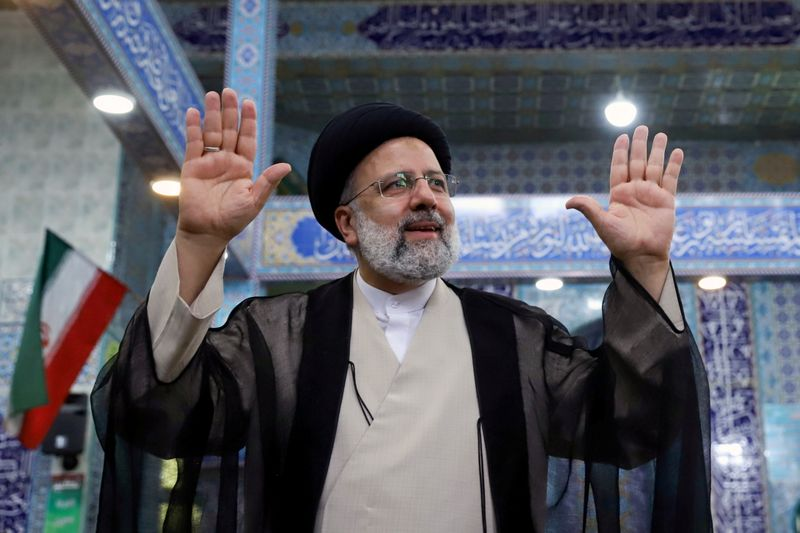 FILE PHOTO: Presidential candidate Ebrahim Raisi gestures after casting his vote during presidential elections at a polling station in Tehran, Iran June 18, 2021. Majid Asgaripour/WANA (West Asia News Agency) via REUTERS