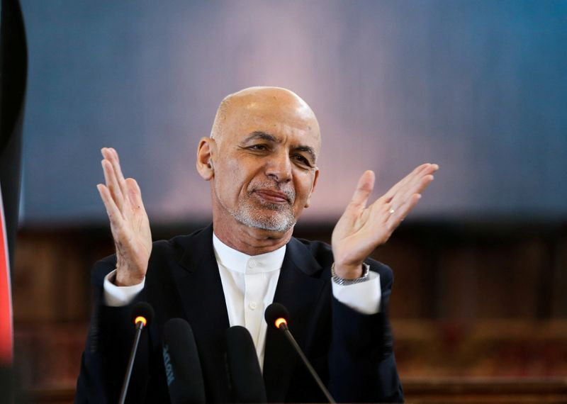 FILE PHOTO: Afghanistan's President Ashraf Ghani gestures during celebrations to mark Afghan New Year (Newroz), in Kabul, Afghanistan March 21, 2021. REUTERS/Omar Sobhani/File Photo