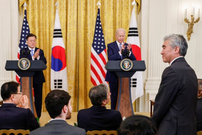 FILE PHOTO: U.S. State Department official Sung Kim stands after U.S. President Joe Biden announced Kim will serve as a special U.S. envoy for North Korea during a joint news conference with South Korea's President Moon Jae-in after a day of meetings at the White House, in Washington, U.S. May 21, 2021. REUTERS/Jonathan Ernst