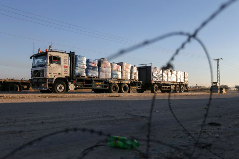 A truck carrying clothes for export is seen at Kerem Shalom crossing in Rafah in the southern Gaza Strip, June 21, 2021. REUTERS/Ibraheem Abu Mustafa