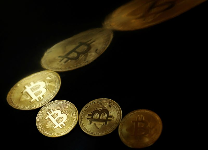 FILE PHOTO: A representation of the virtual cryptocurrency Bitcoin is seen in this picture illustration taken June 14, 2021. REUTERS/Edgar Su/Illustration