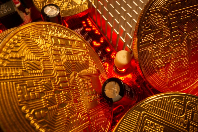 FILE PHOTO: Representations of the virtual currency stand on a motherboard in this picture illustration taken May 20, 2021. REUTERS/Dado Ruvic/Illustration