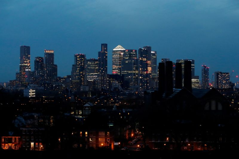 FILE PHOTO: View of Canary Wharf business district at dusk in London, Britain March 9, 2021. REUTERS/Peter Cziborra/File photo