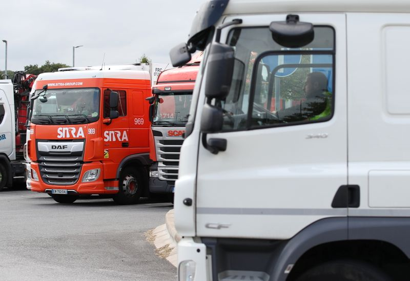 Lorries are seen at an HGV parking, at Cobham services on the M25 motorway, Cobham, Britain, August 31, 2021. Picture taken August 31, 2021. REUTERS/Peter Cziborra/Files