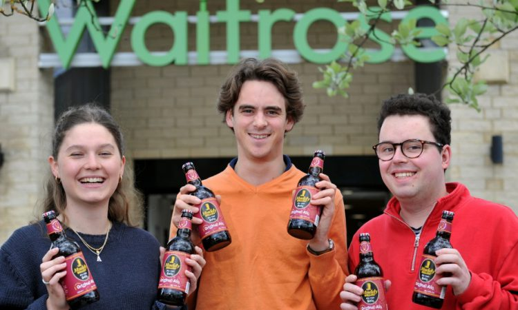 Ag university students raise a glass as their beer hits supermarket shelves