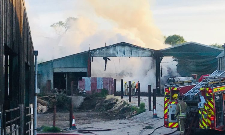 Firefighters tackle blaze affecting 6 barns on Gloucestershire holding