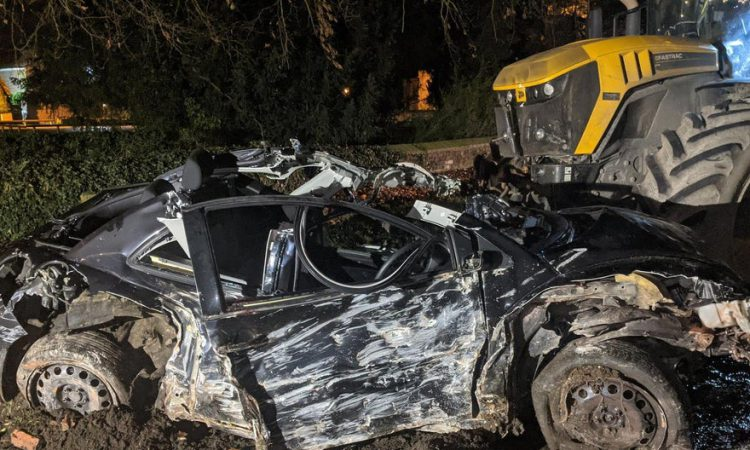 Lack of fatalities in collision between tractor and car described by police as a 'miracle'