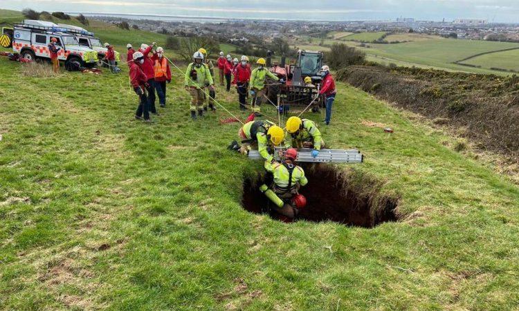 Farmer rescued after falling down 60ft sinkhole in field
