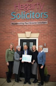 Hegarty Solicitors present For Rutland with a cheque for £5000