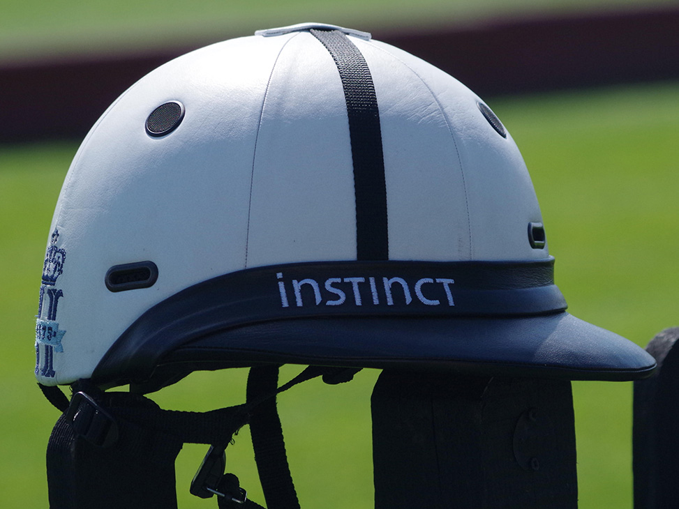 White Leather Helmet with Blue Peak outdoors
