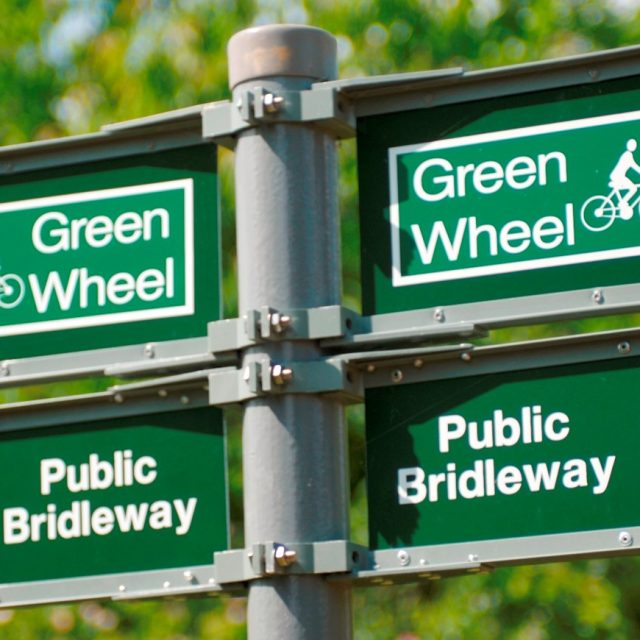 Green Wheel Sign Posts